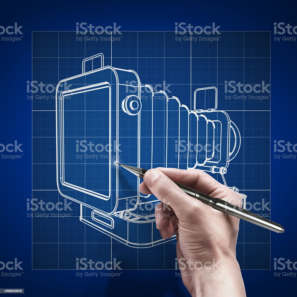 male hand with pen blueprint .Vintage photo camera. stock photo
