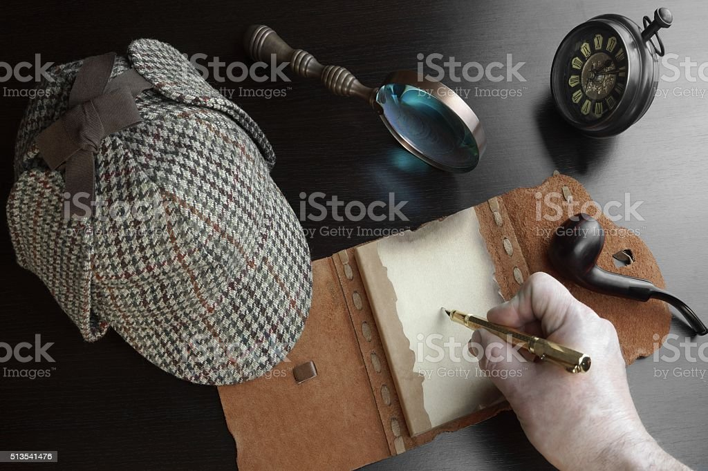 Male Hand With Pen, Open Notebok, Deerstalker Hat, Magnifier, Cl stock photo