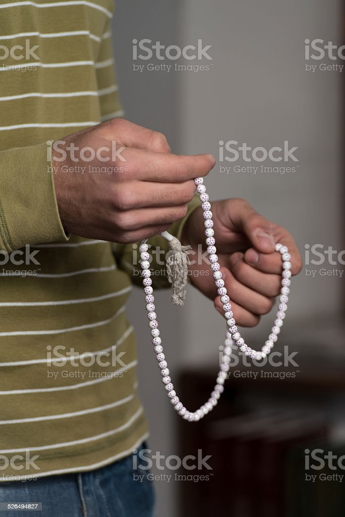 Male Hand With Rosary stock photo