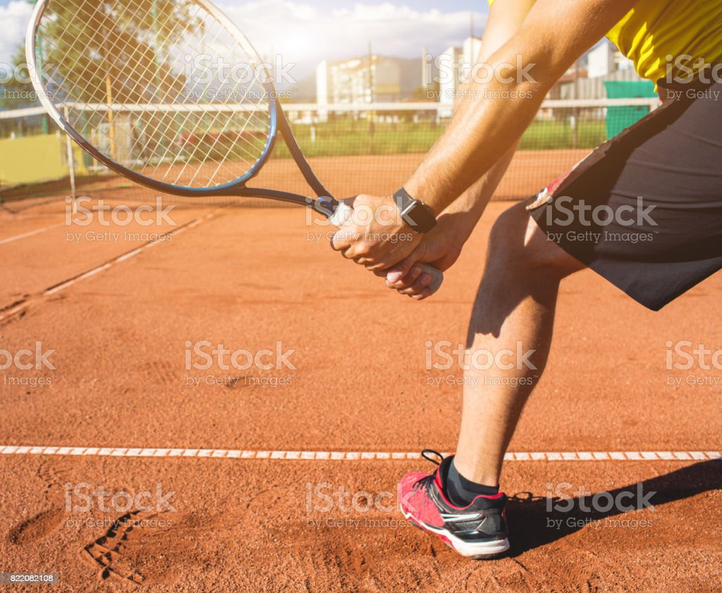Male hand with tennis racket stock photo
