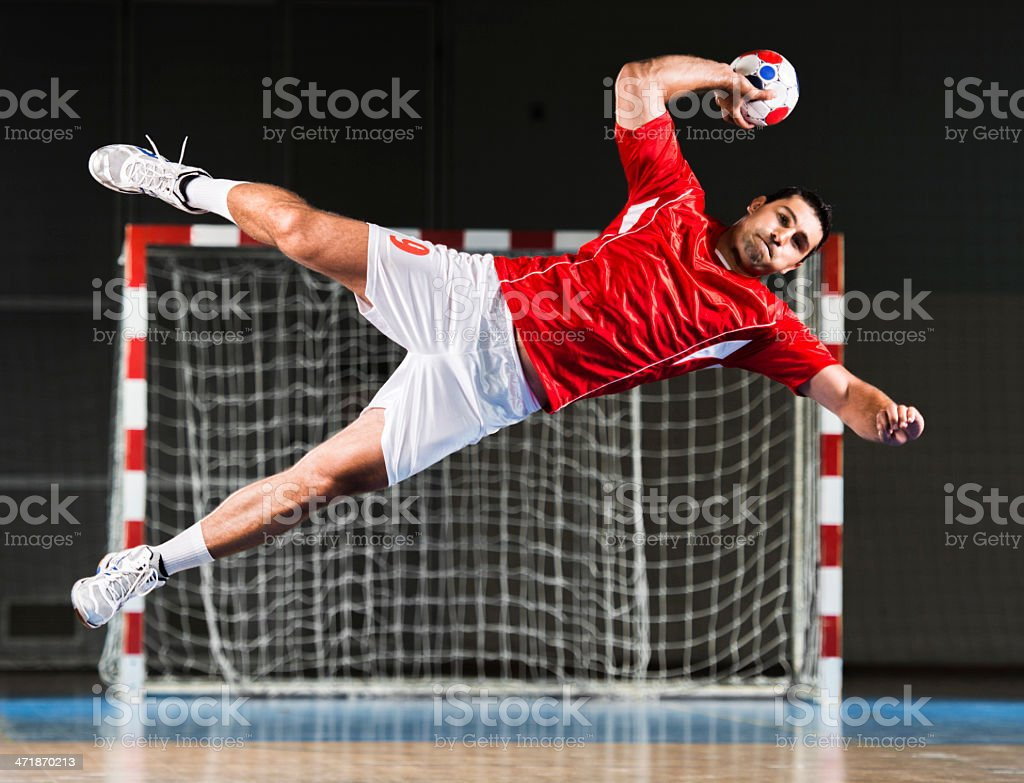 Male handball player in action. stock photo