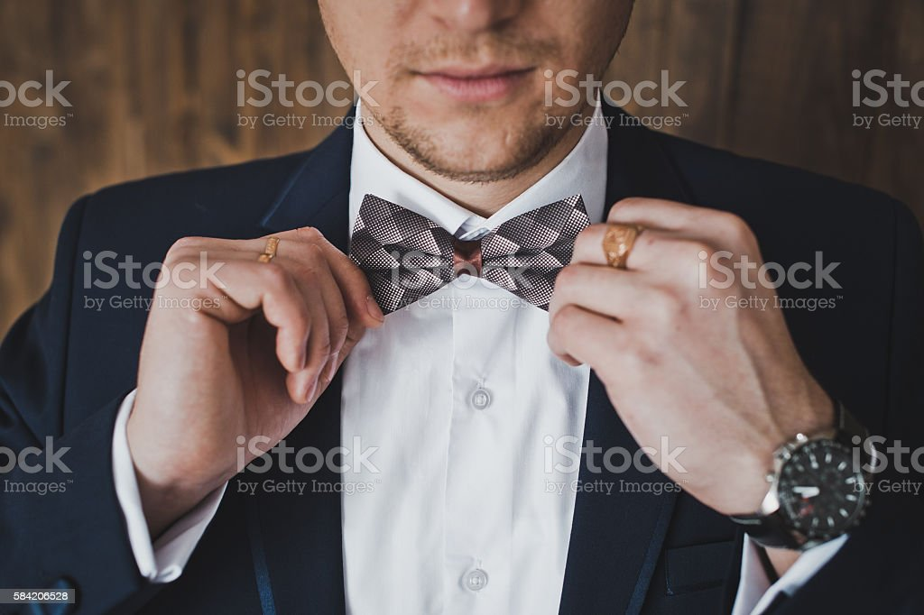 Male hands adjusting the tie stock photo