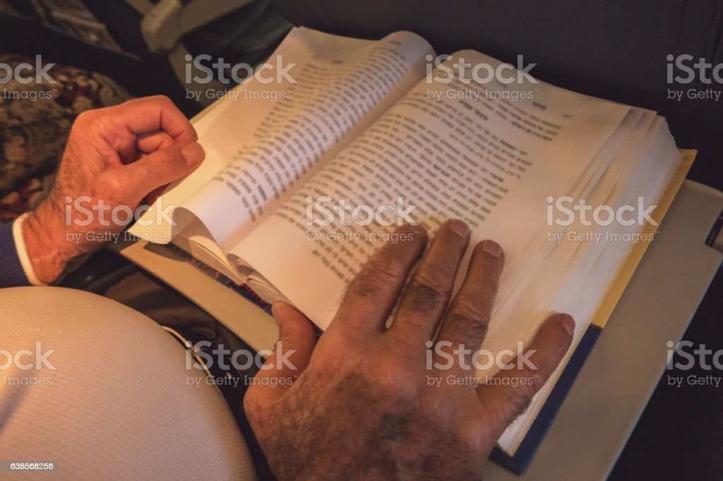 Male hands and opened book. stock photo