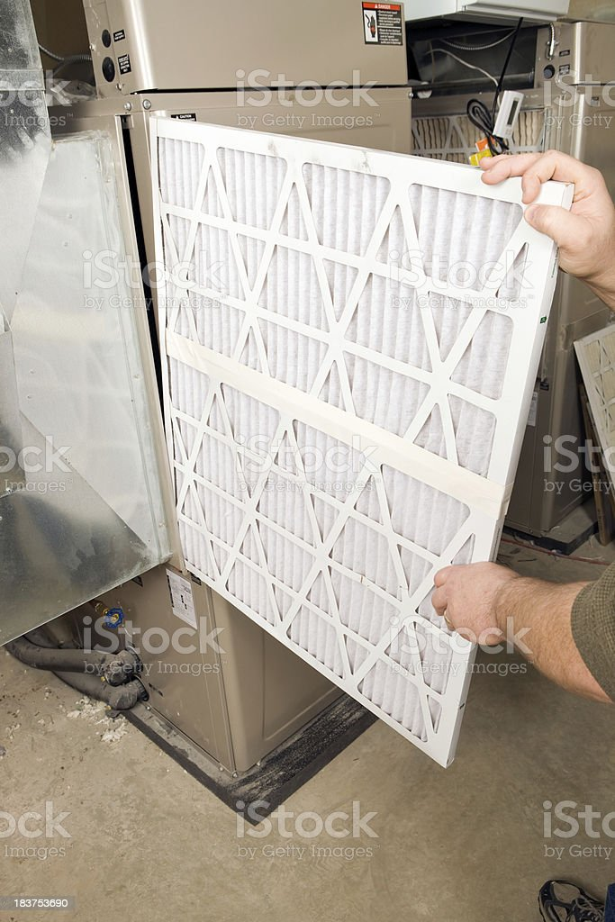 Male Hands Change Large Pleated Furnace Air Filter stock photo