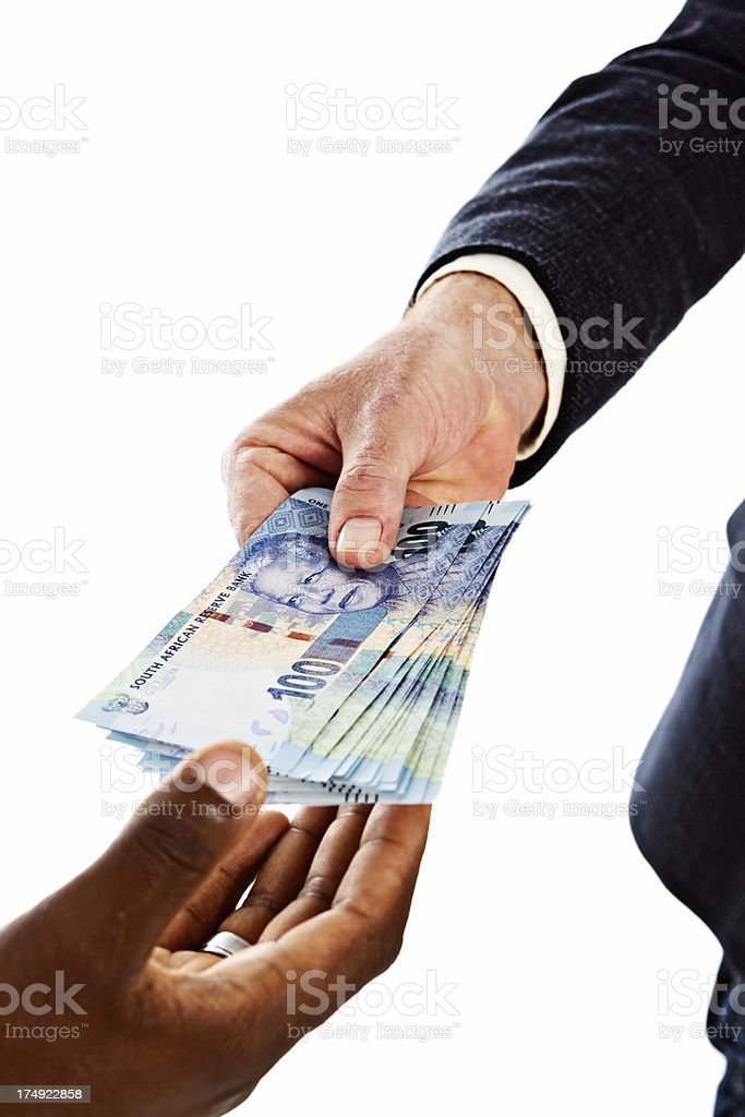 Male hands handing over bundle of One Hundred Rand notes stock photo