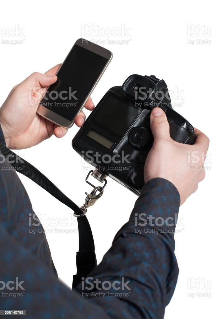 Male hands holding digital camera and mobile phone stock photo