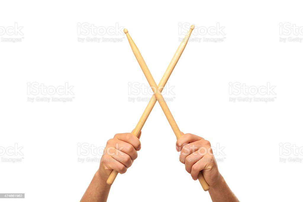 Male hands holding drum sticks stock photo