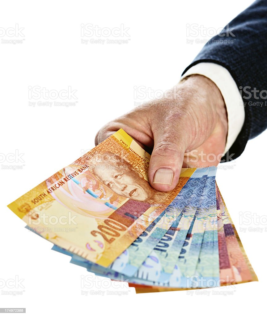 Male hands holding out selection of new South African currency stock photo