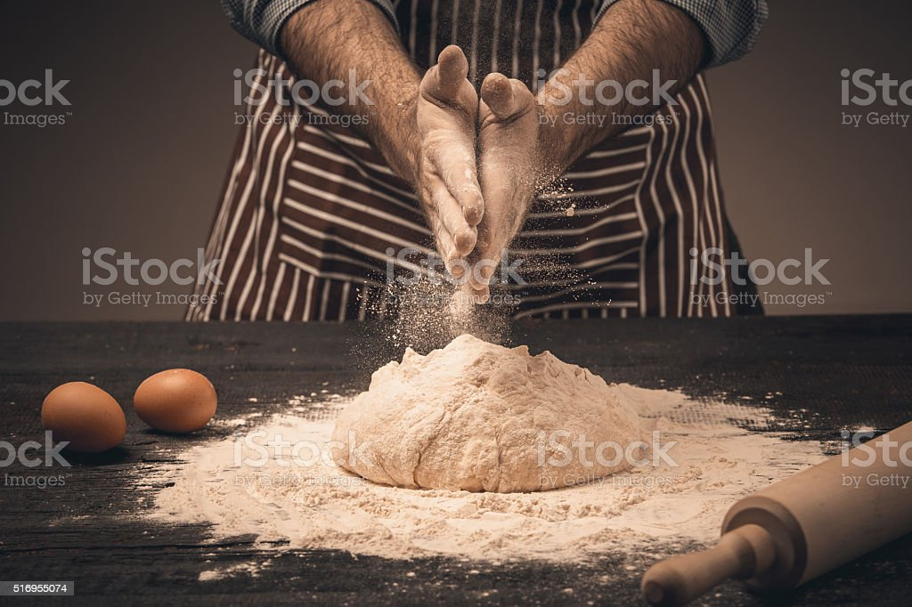 Male hands knead the dough. stock photo