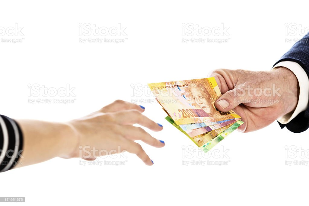 Male hands passing South African banknotes to woman stock photo