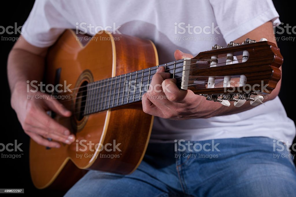 Male hands playing guitar stock photo
