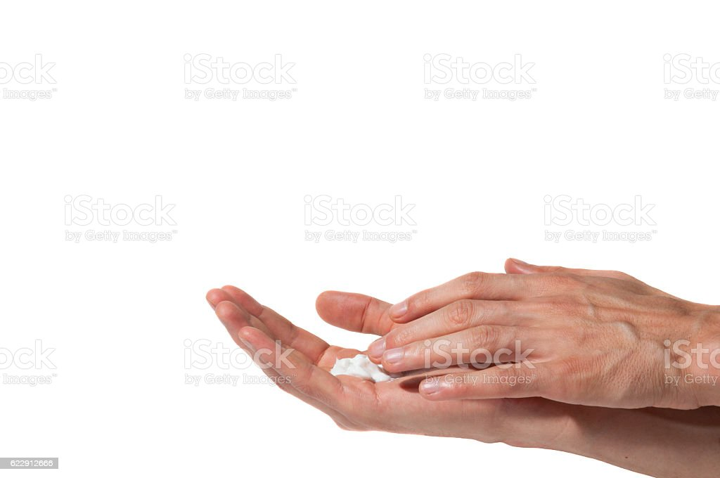 Male hands put on a hands cosmetic cream. Isolated. stock photo