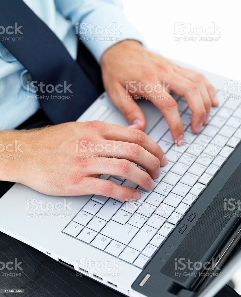 Male hands typing on a laptop royalty-free stock photo