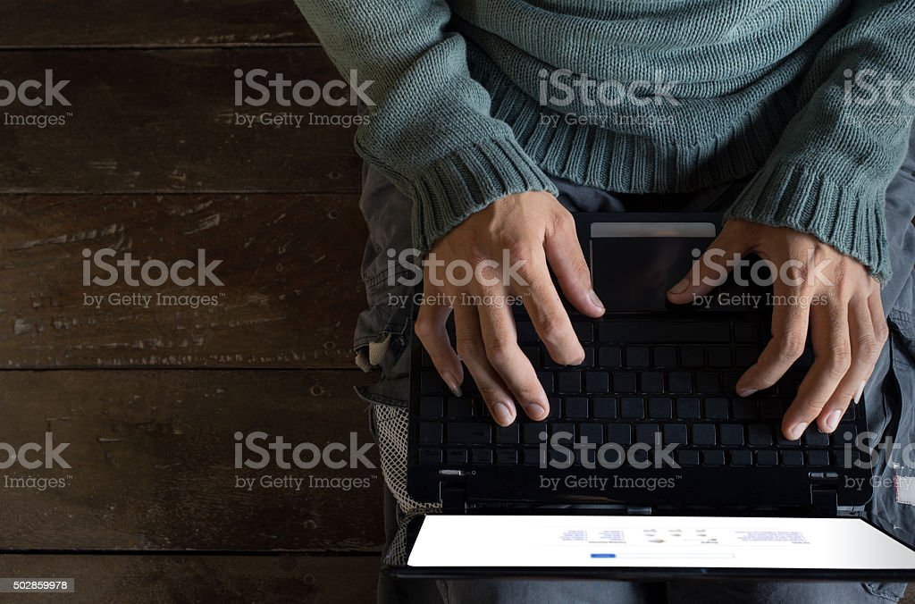 male hands using Laptop stock photo