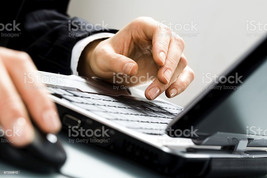 Male hands working on a desktop computer royalty-free stock photo