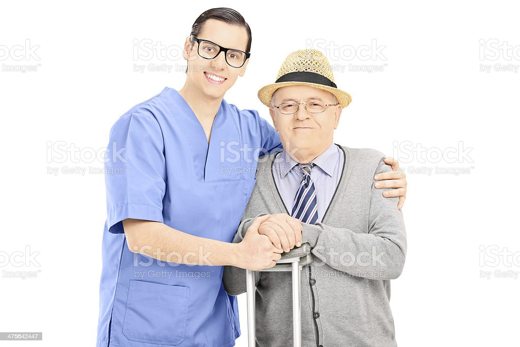 Male healthcare professional and a senior gentleman posing royalty-free stock photo