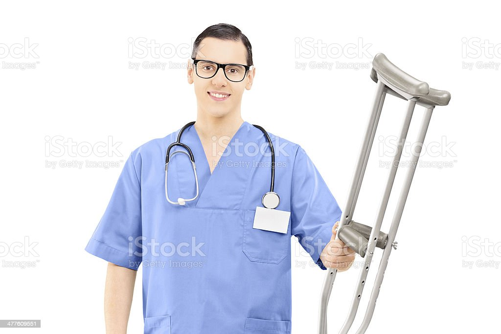 Male healthcare professional holding crutches royalty-free stock photo