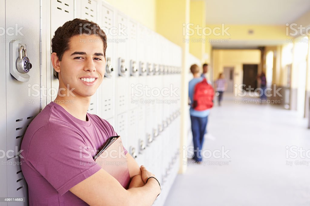 Male High School Student Standing By Lockers stock photo