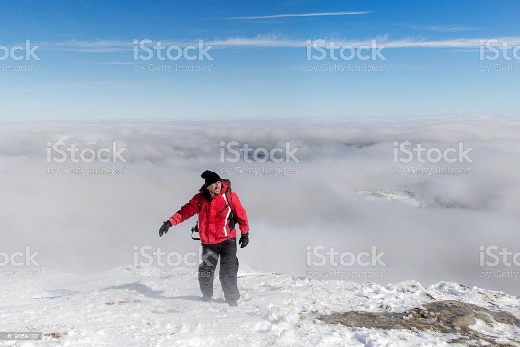 Male hiker in Carpathian mountains on top of snowy peak stock photo