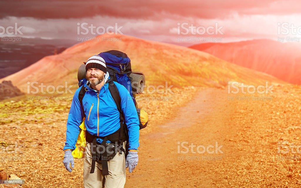 male hiker in the mountains, Iceland stock photo