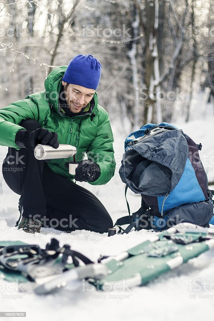Male hiker pouring coffee. royalty-free stock photo