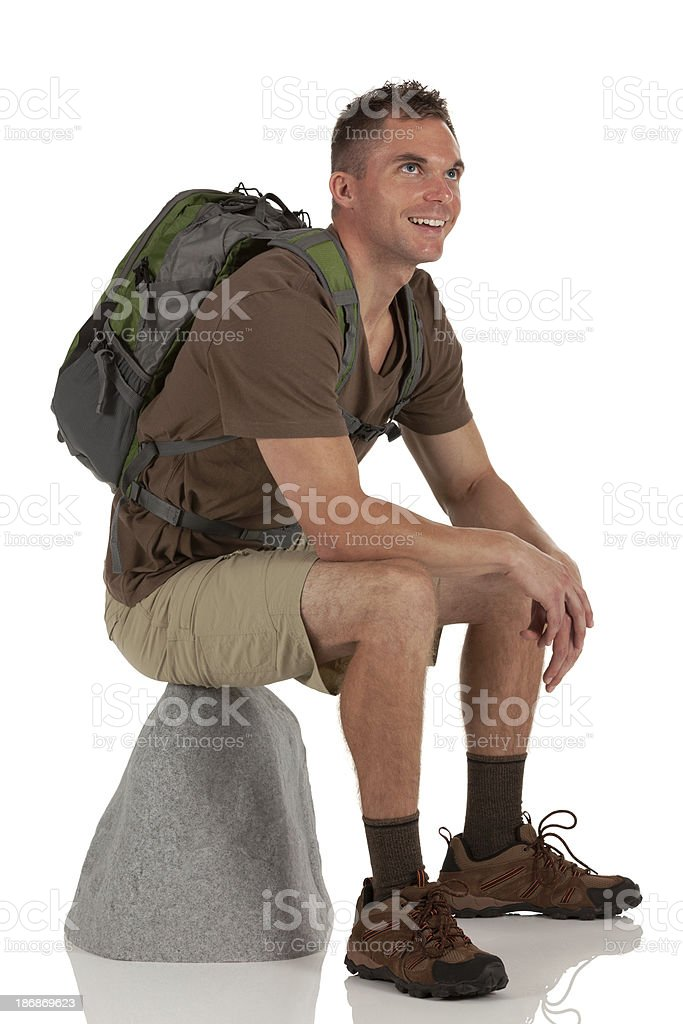 Male hiker sitting on a rock royalty-free stock photo