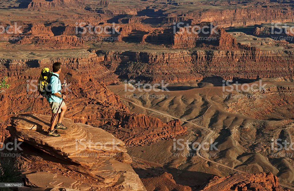 Male Hiker Standing On Top Of Rocks Looking At View royalty-free stock photo
