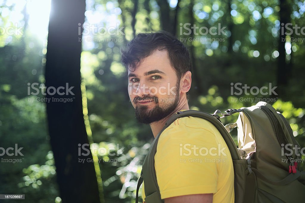Male hiker walking in forest. royalty-free stock photo