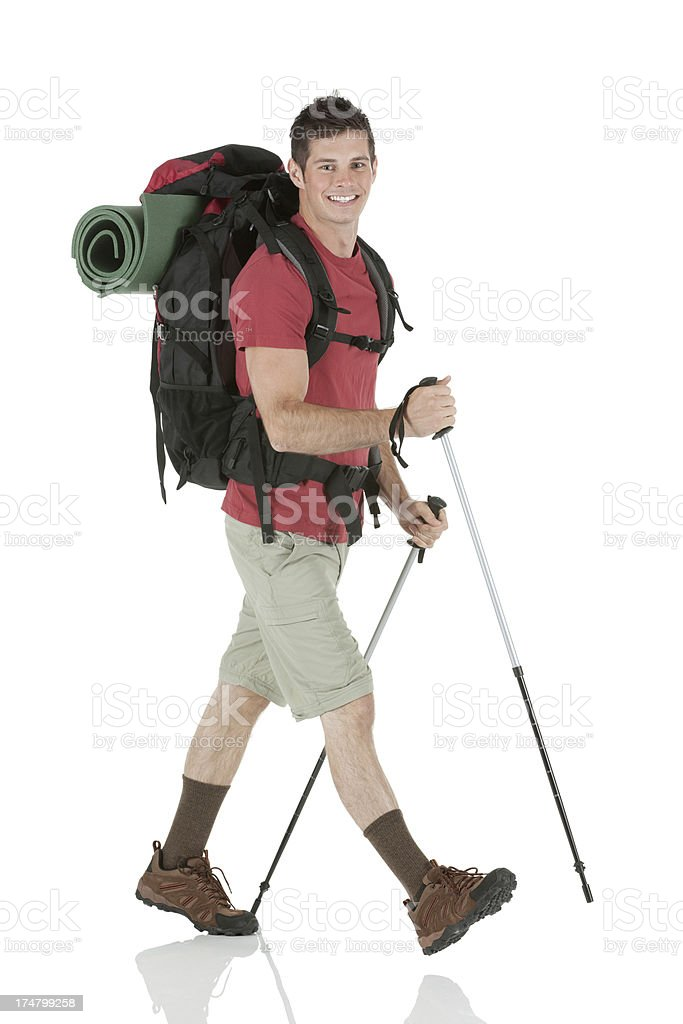 Male hiker walking with hiking pole royalty-free stock photo