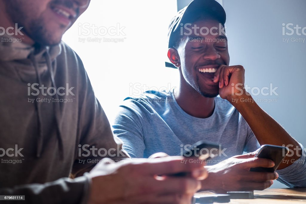 Male Hipster Best Friends and Mobile Phones stock photo