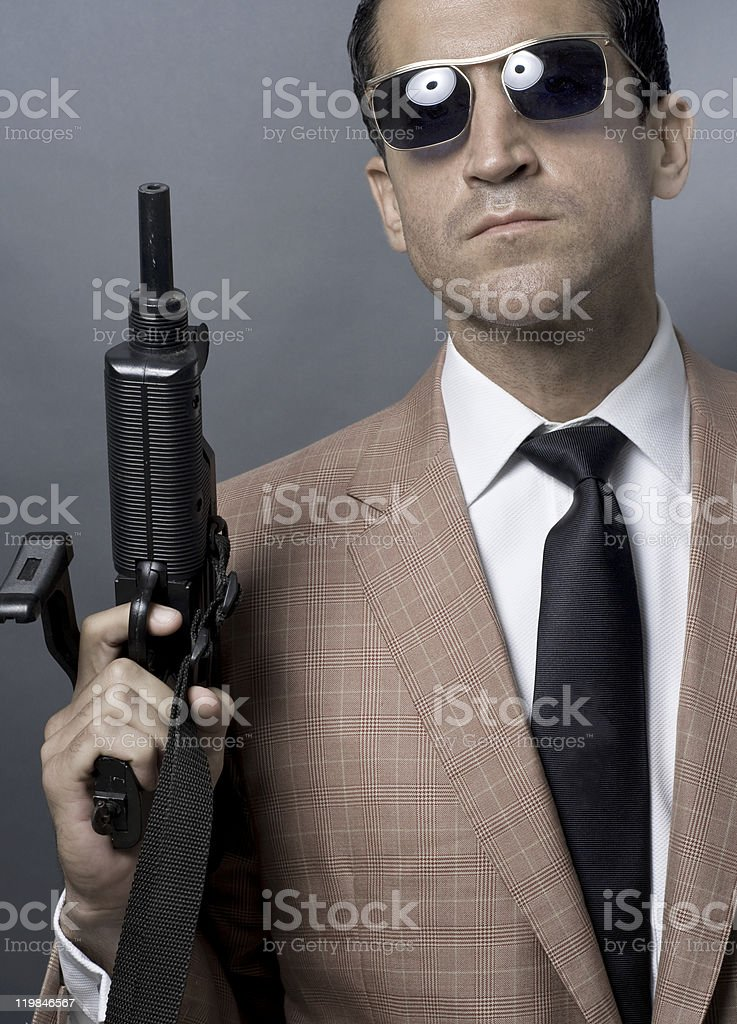 Male Hitman With An Uzi And Wearing A designer Suitcoat stock photo