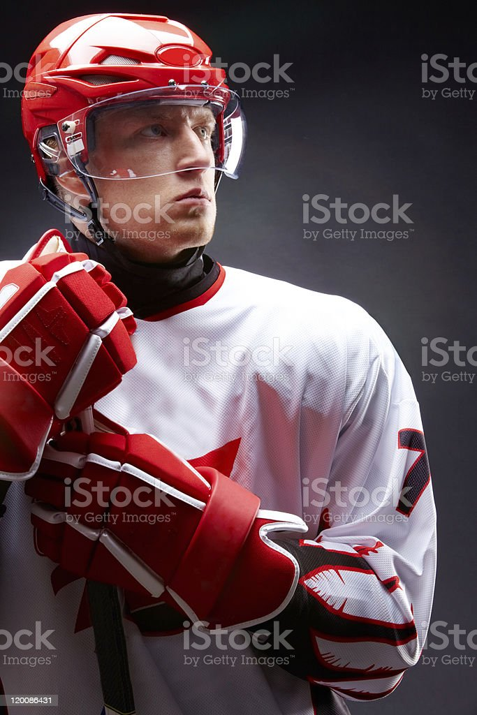 A male hockey player in red and white royalty-free stock photo