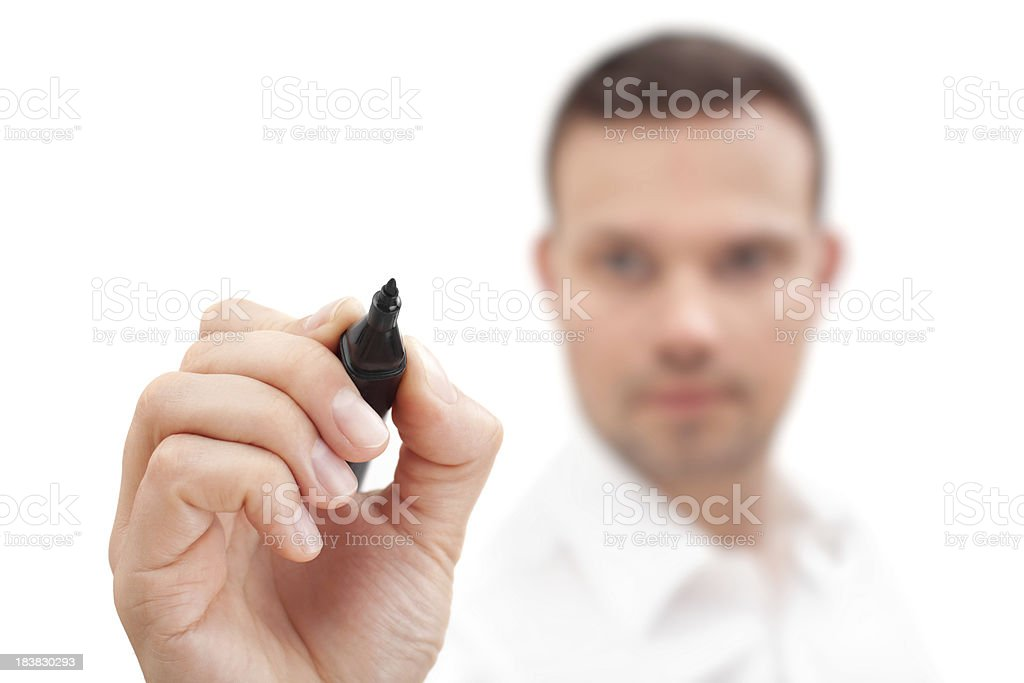 Male holding a marker about to write something on glass royalty-free stock photo