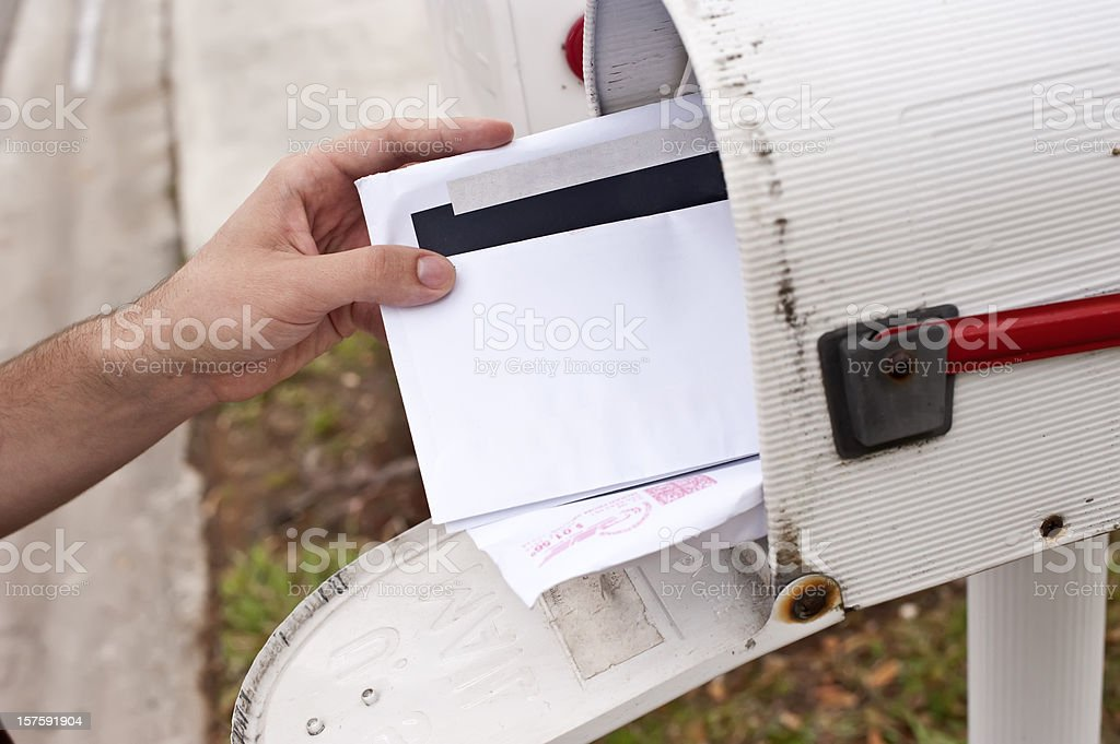 Male human hand getting the mail royalty-free stock photo
