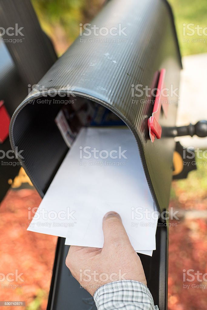 Male human hand getting the mail stock photo