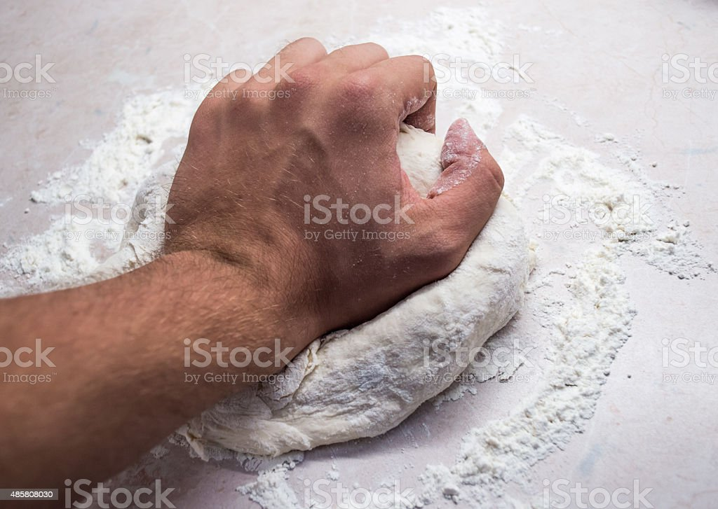 Male Human Hand Kneading Bread Dough royalty-free stock photo