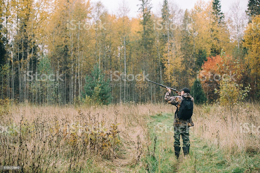 Male hunter in the woods stock photo