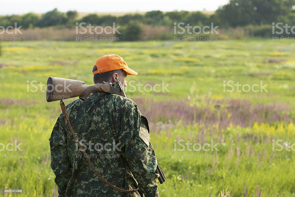 Male hunter looking at field stock photo