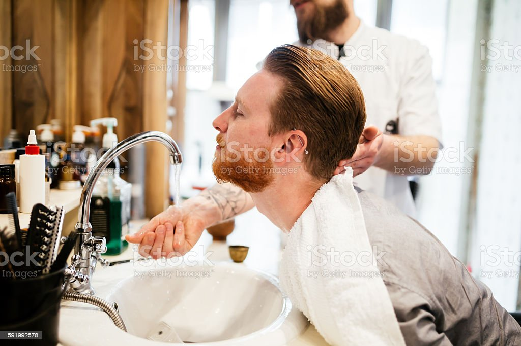 Male in barber shop stock photo