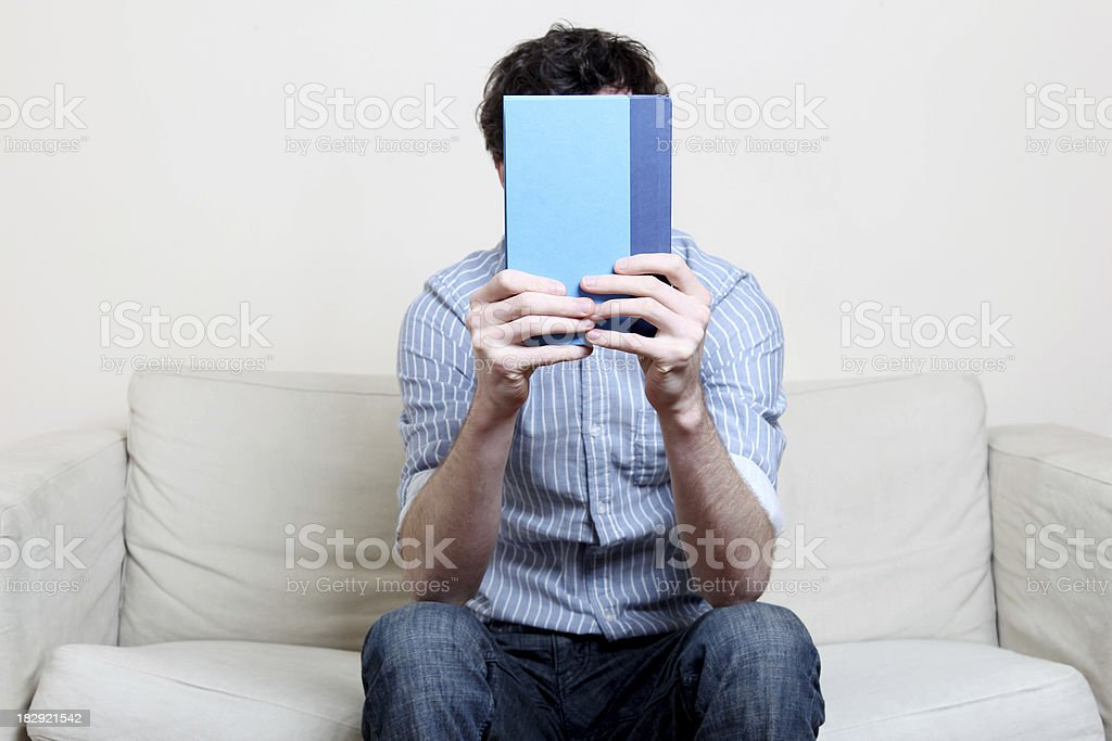 Male in blue shirt reading a book royalty-free stock photo