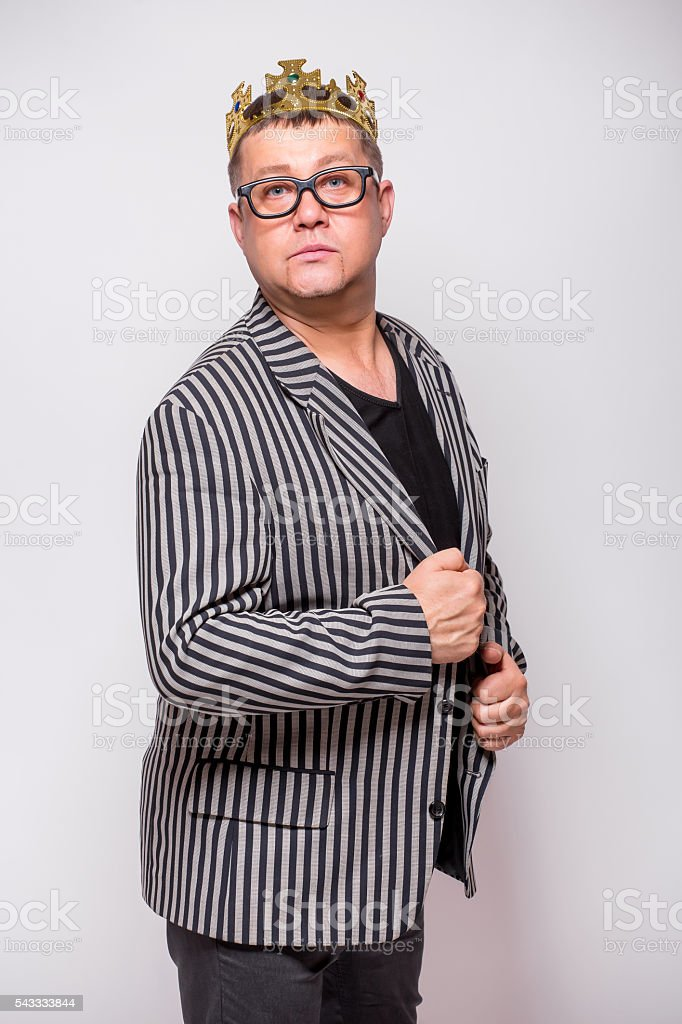 Male in suit and crown  on white back stock photo