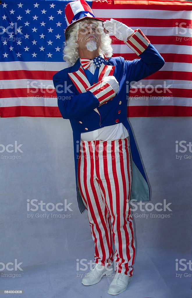Male in Uncle Sam costume saluting stock photo