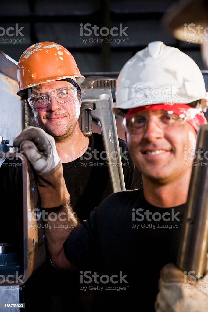 Male industrial workers working in factory stock photo