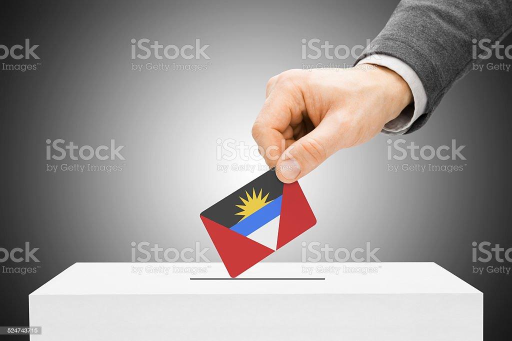 Male inserting flag into ballot box - Antigua and Barbuda stock photo
