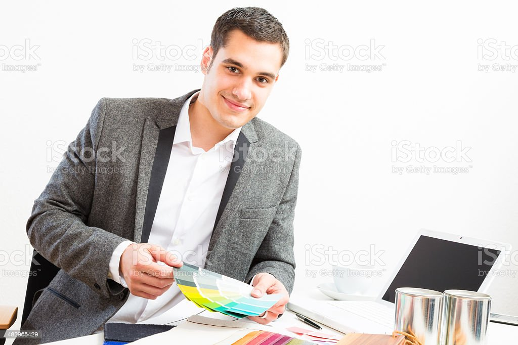 male interior designer at his desk royalty-free stock photo