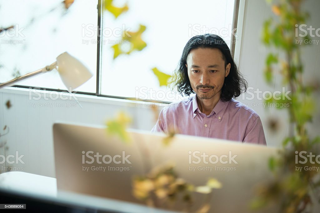 Male Interior designer using computer in design studio stock photo