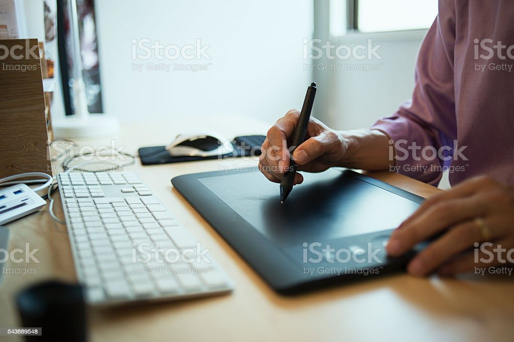 Male Interior designer using designer using digital tablet in studio stock photo
