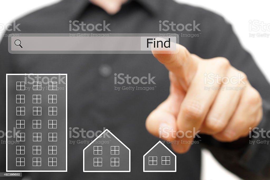 male is using on line search  find proper real estate stock photo