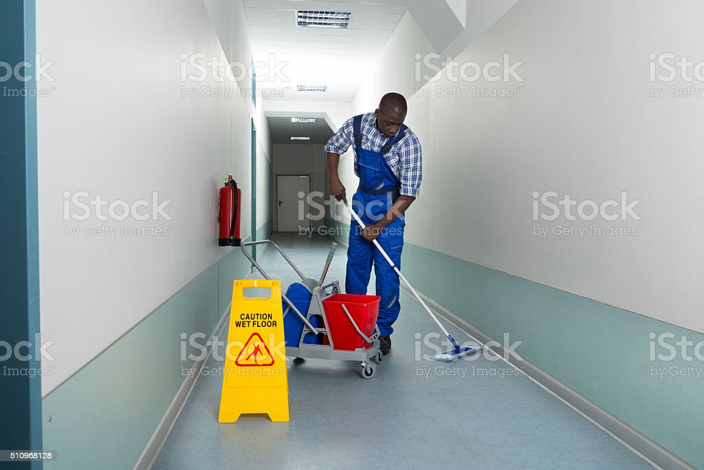 Male Janitor Cleaning Floor stock photo