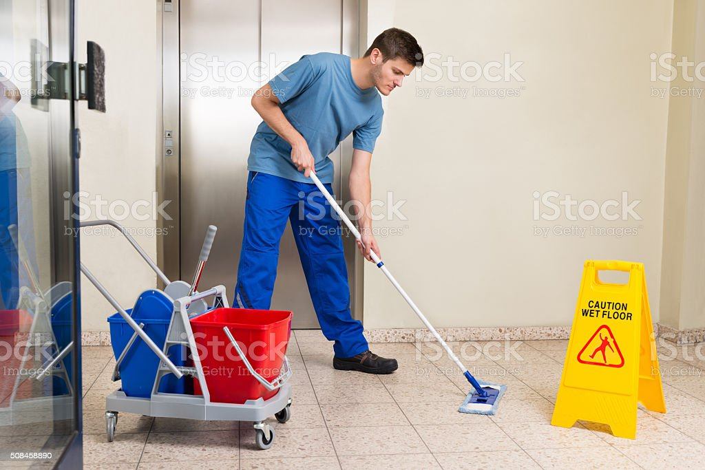 Male Janitor Mopping Floor stock photo